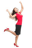 Ecstatic woman dancing of joy. Ecstatic woman dancing and celebrating. Excited happy and joyful asian businesswoman isolated in full length on white background royalty free stock photo