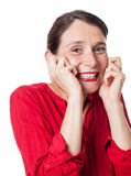 Ecstatic woman giggling expressing childish happiness. Fun toothy smile - portrait of an ecstatic young woman giggling expressing childish happiness and Stock Photo