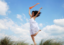Ecstatic woman jumping  Stock Photo