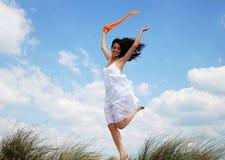 Ecstatic woman jumping  Stock Photo