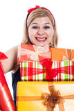 Ecstatic woman with many presents Royalty Free Stock Image