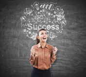 Ecstatic woman near a chalkboard with success Stock Photography