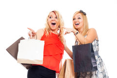 Ecstatic women shopping Stock Images