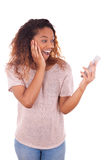 Ecstatic young African American woman making a phone call on her Royalty Free Stock Images