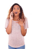 Ecstatic young African American woman making a phone call on her Stock Images