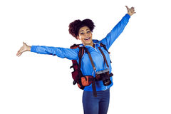 Ecstatic young woman with arms in the air Stock Images