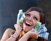 Ecstatic young woman with Euro bills Stock Images