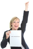 Ecstatic young woman with page of paper. Ecstatic young woman holding up a page of paper or certificate as she punches the air with her fist in jubilation stock photography