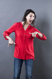 Ecstatic young woman shouting and dancing from alcoholic effects Royalty Free Stock Images