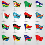Ector sets of waving flags southern africa on silver pole and red one - icon of african states Royalty Free Stock Images