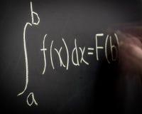Ecuación del cálculo de la escritura Fotos de archivo libres de regalías