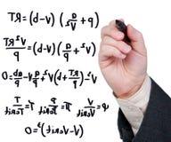 Ecuaciones escritas en etiqueta de plástico en el vidrio. Imagen de archivo