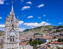 Ecuador, city view of Quito from gothic Basilica del Voto Nacional. Clock tower royalty free stock images
