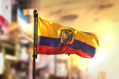 Ecuador Flag Against City Blurred Background At Sunrise Backligh. T Sky Royalty Free Stock Images