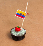 Ecuador flag. Apple Cupcake with red apple shape bonbon on the top Royalty Free Stock Photos