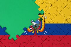 Ecuador flag is depicted on a completed jigsaw puzzle with free green copy space on the left side.  royalty free stock photos
