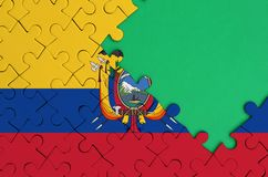 Ecuador flag is depicted on a completed jigsaw puzzle with free green copy space on the right side.  stock illustration