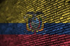 Ecuador flag is depicted on the screen with the program code. The concept of modern technology and site development.  stock images