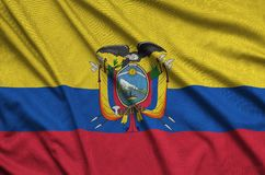 Ecuador flag is depicted on a sports cloth fabric with many folds. Sport team banner. Ecuador flag is depicted on a sports cloth fabric with many folds. Sport royalty free stock photo