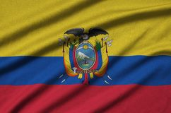 Ecuador flag is depicted on a sports cloth fabric with many folds. Sport team banner. Ecuador flag is depicted on a sports cloth fabric with many folds. Sport royalty free stock image