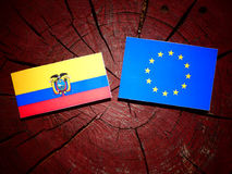 Ecuador flag with EU flag on a tree stump isolated. Ecuador flag with EU flag on a tree stump Royalty Free Stock Images