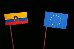 Ecuador flag with European Union EU flag isolated on black. Background Royalty Free Stock Photos