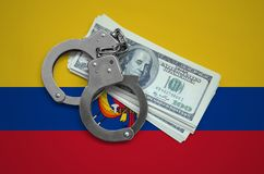 Ecuador flag with handcuffs and a bundle of dollars. Currency corruption in the country. Financial crimes.  stock photos