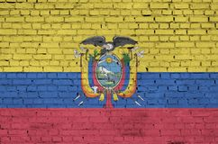 Ecuador flag is painted onto an old brick wall vector illustration