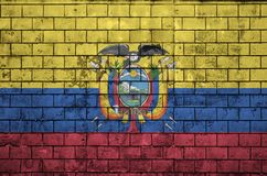 Ecuador flag is painted onto an old brick wall stock image