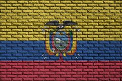 Ecuador flag is painted onto an old brick wall royalty free stock photos