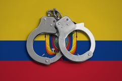 Ecuador flag and police handcuffs. The concept of observance of the law in the country and protection from crime.  stock images