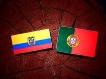 Ecuador flag with Portuguese flag on a tree stump isolated. Ecuador flag with Portuguese flag on a tree stump stock illustration