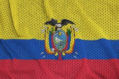 Ecuador flag printed on a polyester nylon sportswear mesh fabric. With some folds royalty free stock images