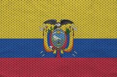 Ecuador flag printed on a polyester nylon sportswear mesh fabric. With some folds stock photos