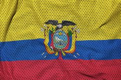 Ecuador flag printed on a polyester nylon sportswear mesh fabric. With some folds royalty free stock photos