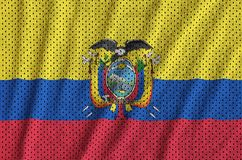 Ecuador flag printed on a polyester nylon sportswear mesh fabric. With some folds royalty free stock photography