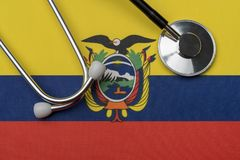 Ecuador flag and stethoscope. The concept of medicine. Stethoscope on the flag as a background stock images