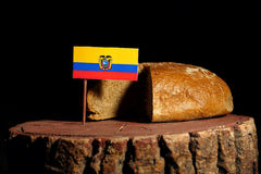 Ecuador flag on a stump with bread. Isolated royalty free stock image