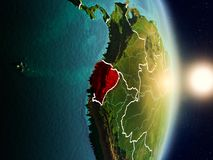 Ecuador during sunrise. Highlighted in red on planet Earth with visible country borders. 3D illustration. Elements of this image furnished by NASA Royalty Free Stock Images