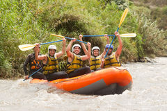 Ecuador Whitewater River Rafting. Group Of Powerful Young Men On A Rafting Boat Patate River Ecuador Shoot From Water Level Stock Image