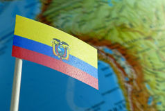 Ecuadorean flag with a globe map as a background Royalty Free Stock Photography