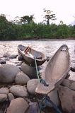 Ecuadorian Canoes. A pair of Amazonian type canoes moored on the rocky shore of the Puyo river, Ecuador Stock Photography
