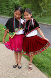 Ecuadorian Costume. Two girls wear traditional Ecuadorian outfits Stock Photos