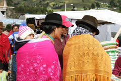 Ecuadorian ethnic people with indigenous clothes in a rural Saturday market in Zumbahua village, Ecuador. Stock Photos