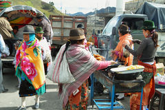 Ecuadorian ethnic people selling cooked food Royalty Free Stock Photography