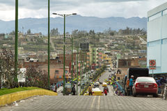 Ecuadorian ethnic people and traffic in te street Stock Photography