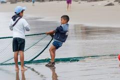 Ecuadorian fishermen pulling in their nets Royalty Free Stock Image