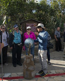 Ecuadorian guide with travelers at the equator Royalty Free Stock Image