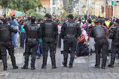 Ecuadorian police standing by in Cotacachi Royalty Free Stock Photo