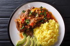 Free Ecuadorian Seco De Chivo Stewed Goat Meat With A Side Dish Of Ye Royalty Free Stock Image - 114862526